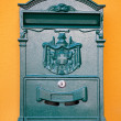 Old Italian letterbox on yellow wall — Stock Photo