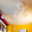 White ballons in yellow and fuchsia room — Stock Photo