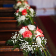 Stock Photo: Bouquets in Catholic Church.