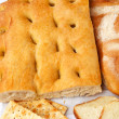Closeup of genoese focaccia, bread and crackers. — Stock Photo #28326567