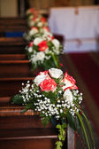 Bouquets in Catholic Church. — Stock Photo