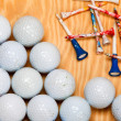 Stock Photo: Dirty golf balls and tees