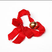 Jingle bell with a red ribbon — Stock Photo