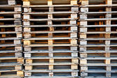 Piles of wooden pallets. — Stock Photo