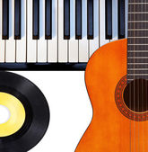Guitar, piano and vinyl record. — Stock Photo