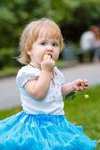 Girl eating an apple — Stock Photo