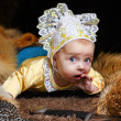 Stock Photo: Baby, fox pelt and sword