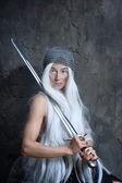 Girl with sword — Stock Photo