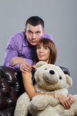 Boy, girl and teddy bear — Stock Photo