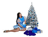 Attractive girl near Christmas tree and gifts — Stock Photo