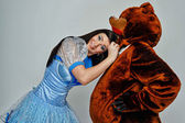 Attractive young girl and bear — Stock Photo