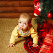 Baby gifts and Christmas tree — Stock Photo