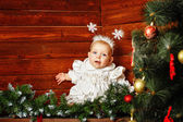 Cute little girl dressed as snowflakes — Stock Photo