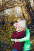 Young couple on banks of river — Stock Photo