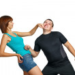 Stock Photo: Girl beats her boyfriend