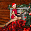 Teenager girl near Christmas tree — Stock Photo