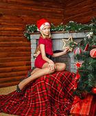 Teenager girl near Christmas tree — Stock Photo