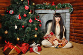 Girl with gifts near Christmas tree — Stock Photo