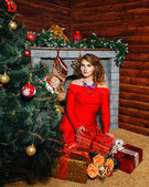 Girl in red dress Christmas tree — Stock Photo