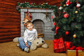 Boy and Christmas tree — Foto Stock