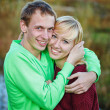Young couple on banks of river — Stock Photo #37855127