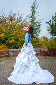 Bride in city park — Stock Photo