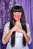 Girl and lollipop — Stock Photo