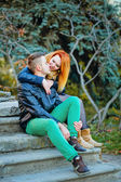 Couple sitting on stairs — Stock Photo