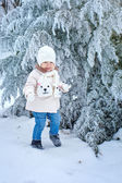 Child walking in winter forest — Stock Photo