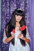 Girl and lollipop broken heart — Stock Photo