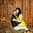 Young couple on hayloft — Stock Photo
