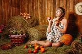 Girl in rustic barn — Stock Photo
