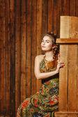 Rural girl in barn — Stock Photo