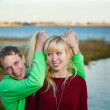 Couple fooling around on sea bank — Stock Photo