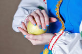 Girl holding apple — Foto de Stock