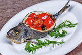 Dorado fish with vegetables — Stock Photo