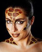 Girl with make-up giraffe — Stock Photo