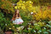 Girl in garden — Stock Photo