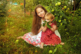 Sister in the garden — Stock Photo