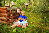 Sister and brother in the garden — Stock Photo