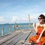 Sexy Woman on the bridge above sea — Stock Photo #32501189