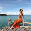 Sexy Woman on the bridge above sea — Stock Photo