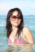 Pretty woman posing in the sea — Stock Photo