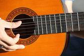 Guitar played outdoors — Stock Photo