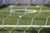 White football net, green grass ,futsal goal — Stock Photo
