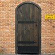 Wooden vintage closed door with brick wall to the house — Stock Photo