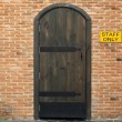 Stock Photo: Wooden vintage closed door with brick wall to the house