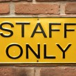 Staff only sign on brick wall — Foto de Stock