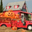 Halloween pumpkins on red Fire truck  — Stock Photo