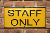 Staff only sign on brick wall — Stock Photo